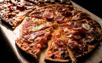 pizza cut on pizza board